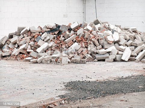 A pile of old damaged bricks and concrete blocks.