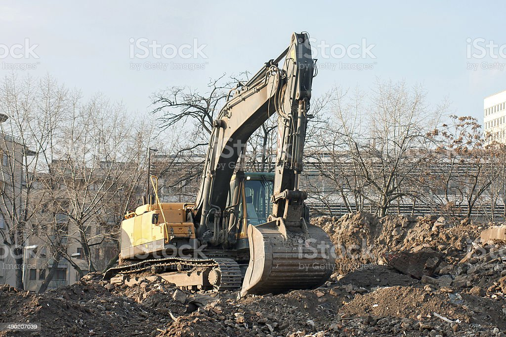 Demolition truck in action. Demolition of an old block of flats. stock photo