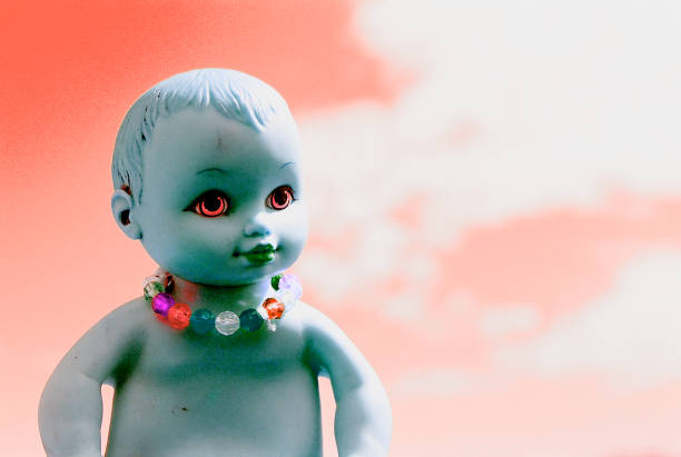 demon baby doll surrounded by a red sky - demoniac stock pictures, royalty-free photos & images