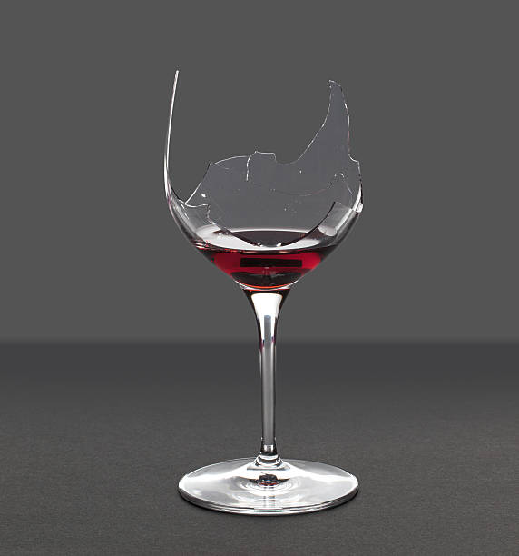 Demon drink red wine in glass stock photo