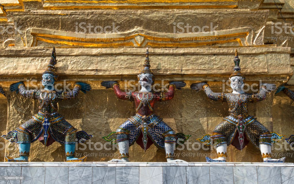Demon guardian in Wat Phra Kaew, Bangkok famous landmark of Thailand, Temple of the Emerald Buddha. stock photo