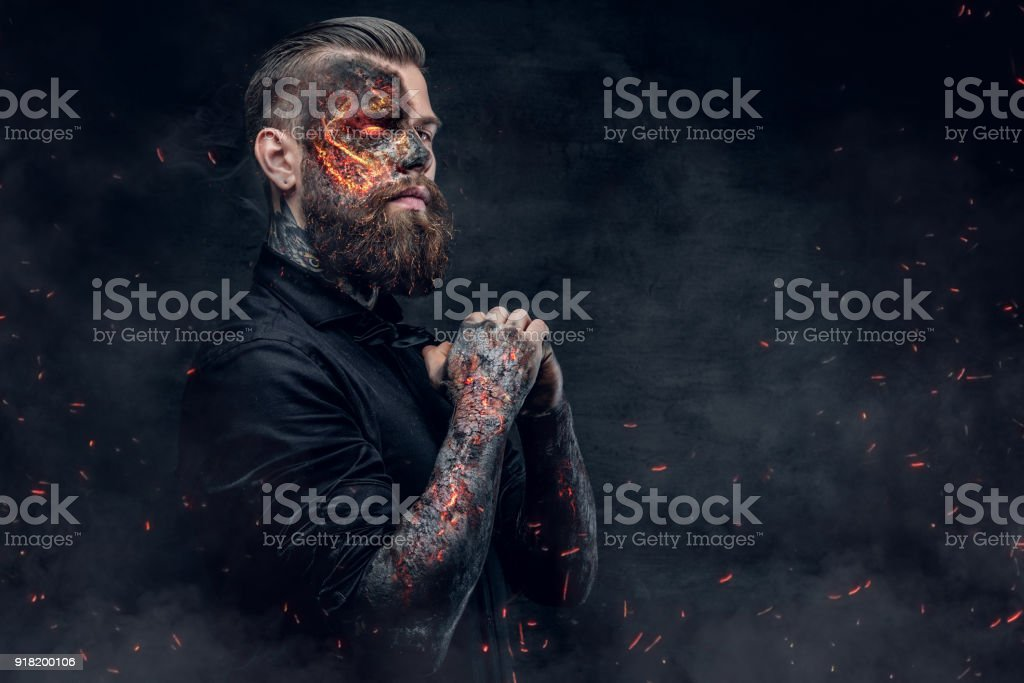 A demon man with a burning face. stock photo