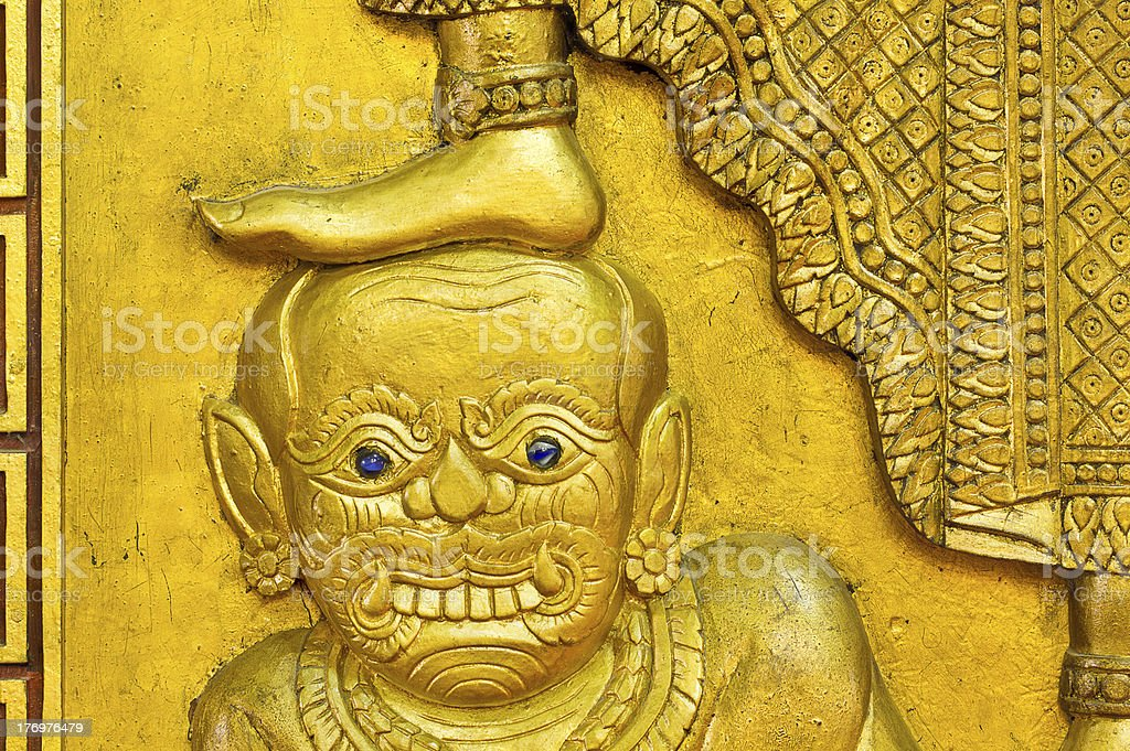 demon statue under foot royalty-free stock photo