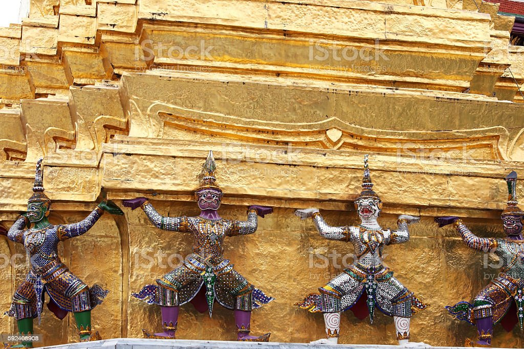 demon which support golden chedi. stock photo
