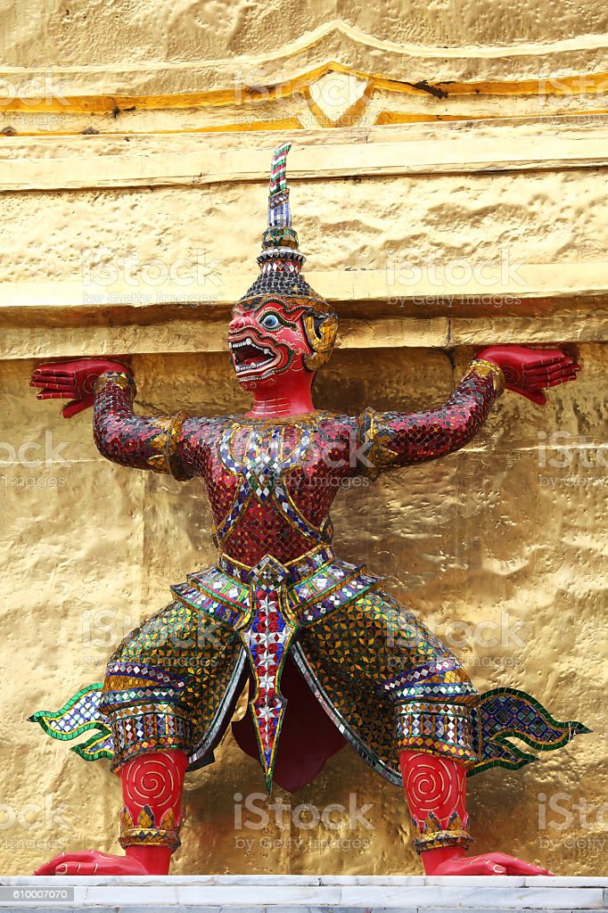 demon which support golden chedi stock photo