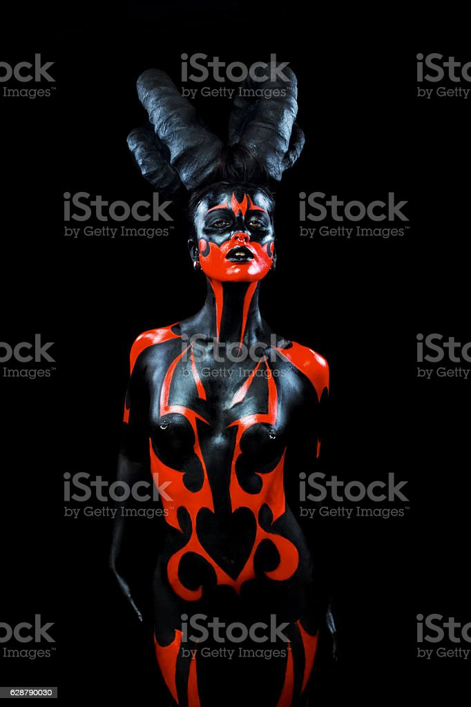 Demon woman with horns stock photo