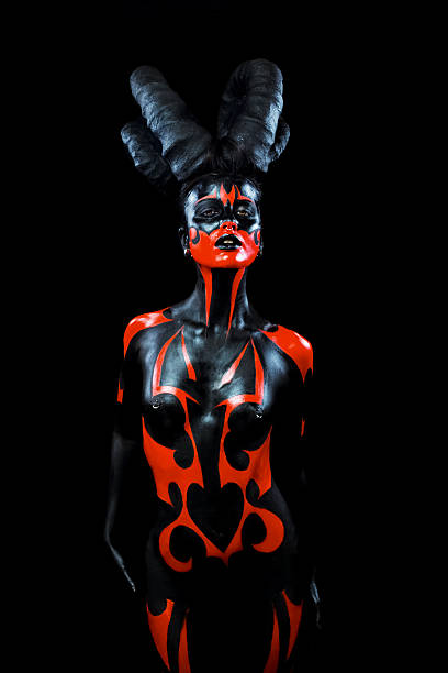 Demon woman with horns - Photo