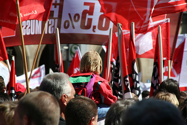 "A demonstration of a group of people practicing their rights ""May demonstration for higher salaries, organized by German Unions.Banners with slogans (Logos got removed)"" labor union stock pictures, royalty-free photos & images"