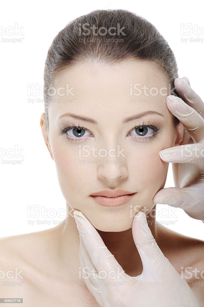 Demonstration of cosmetic medicine procedures on young woman royalty-free stock photo