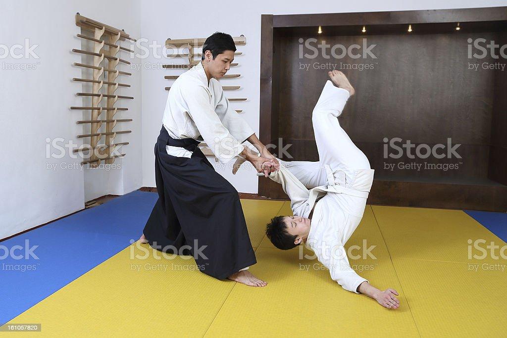 Demonstration of fighting art Aikido. stock photo