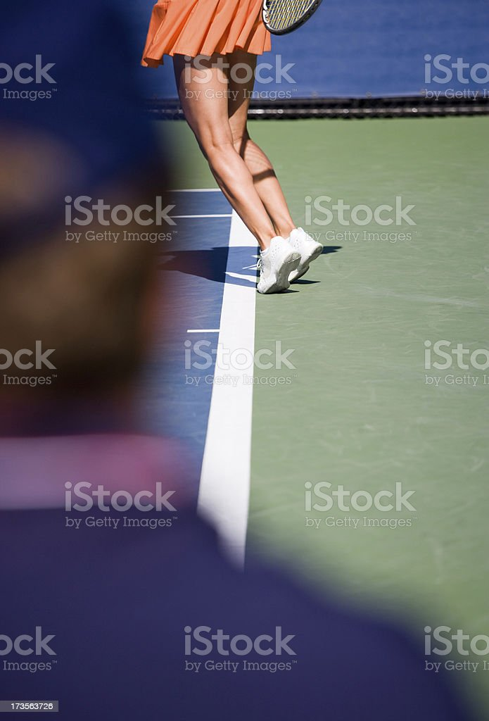 A demonstration of no foot fault in a tennis serve. royalty-free stock photo