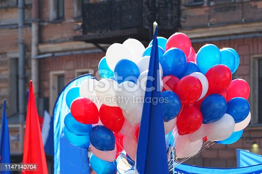 Demonstration on the streets of city. Flags, banners and balls. Red, white and blue color. Political rally