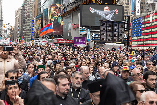 Demonstration New York, NY USA - April 26, 2015: Thousands rally in Manhattan Times Square to mark centennial of the deaths of 1.5 million Armenians under the Ottoman Empire in 1915 armenian genocide stock pictures, royalty-free photos & images