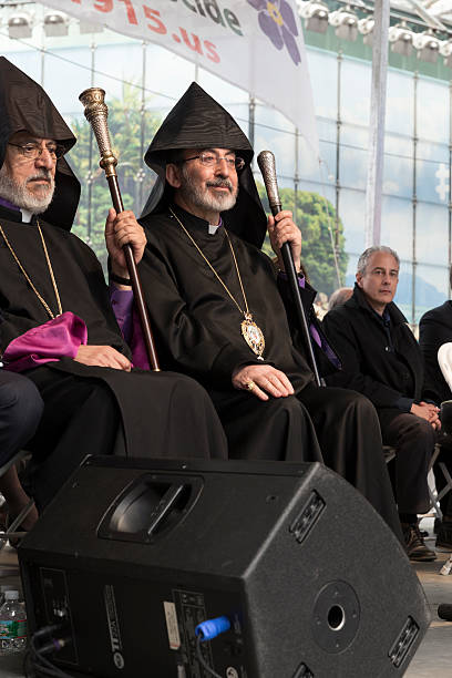 Demonstration New York, NY USA - April 26, 2015: Archbishop Khajag Barsamian attends rally in Manhattan Times Square to mark centennial of the deaths of 1.5 million Armenians under the Ottoman Empire in 1915 armenian genocide stock pictures, royalty-free photos & images
