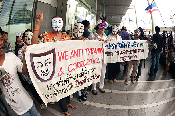demonstrators from the anti-goverment wearing guy fawkes masks. - guy fawkes mask stock photos and pictures