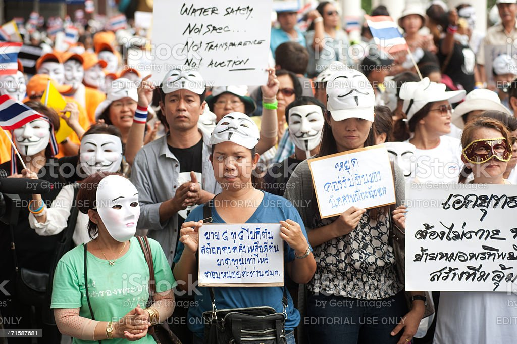 Demonstrators from the anti-goverment wearing Guy Fawkes masks. royalty-free stock photo