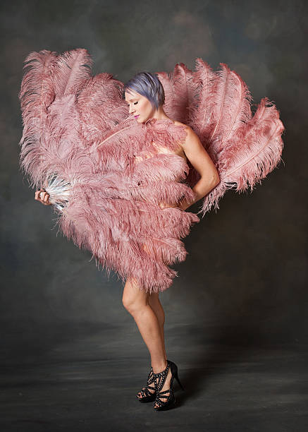 demure burlesque dancer - burlesque stock photos and pictures