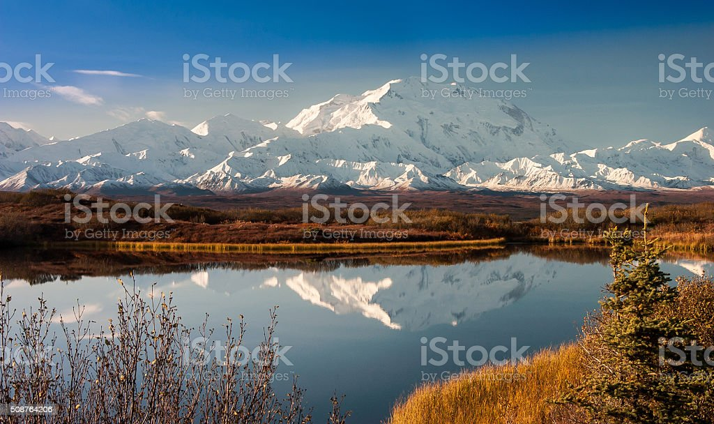 Denali Mountain in Fall Reflected in Wonder Lake, Alaska stock photo