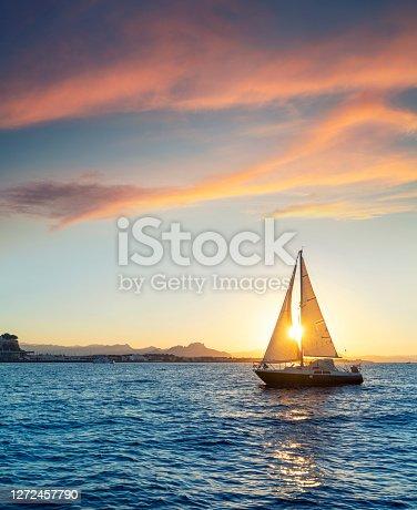 Denia sunset sailboat from the Mediterranean sea of Alicante Spain