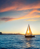 Denia sunset sailboat from the Mediterranean sea of Alicante Spain