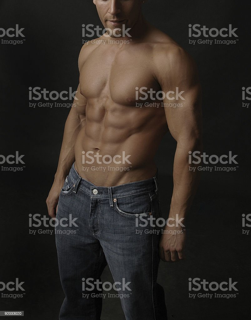 Denim and a six pack royalty-free stock photo
