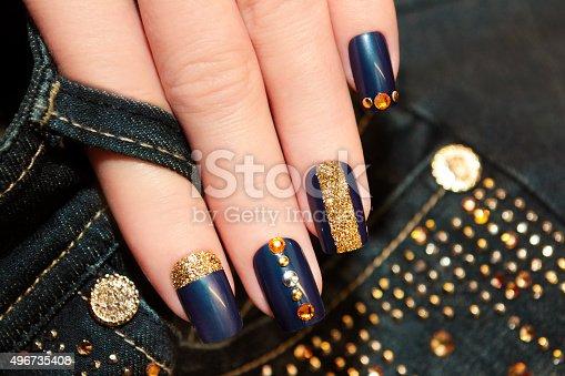 istock Denim blue manicure. 496735408