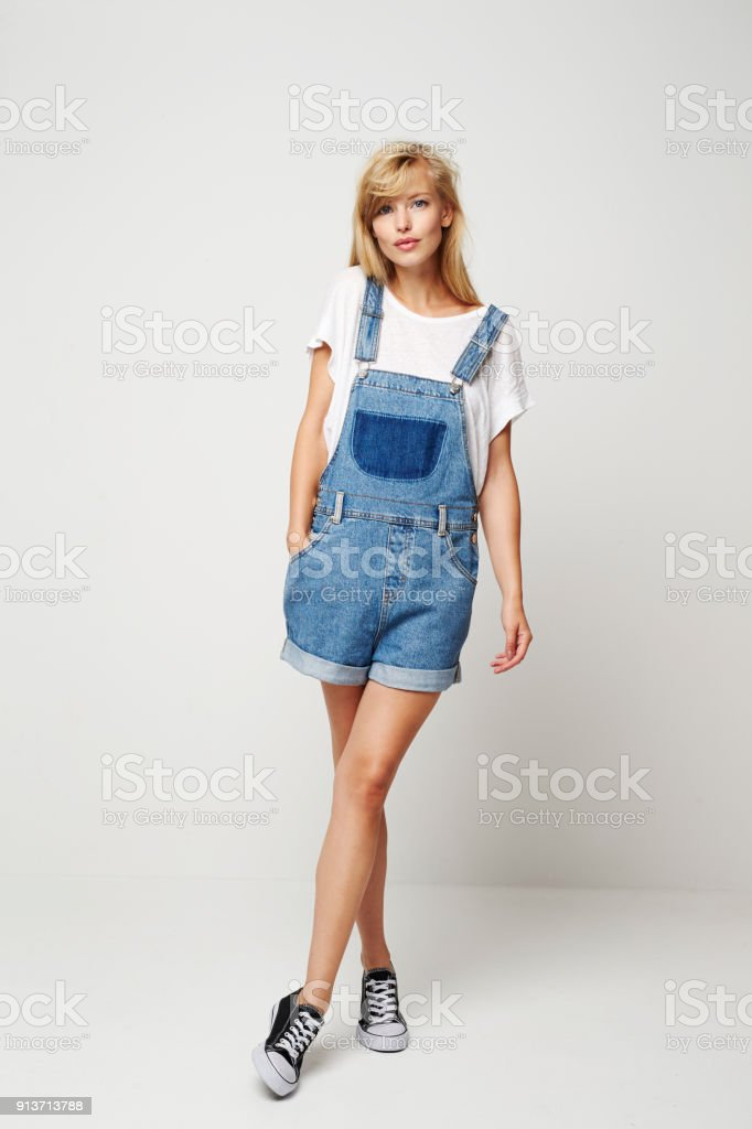Denim dungaree woman stock photo