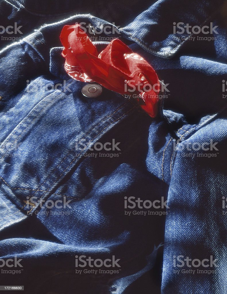 Denim Jacket with red accent stock photo