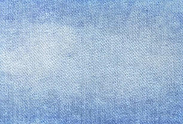 Denim jeans texture. Denim background texture for design. Canvas denim texture. Blue denim that can be used as background. Blue jeans texture for any background. stock photo