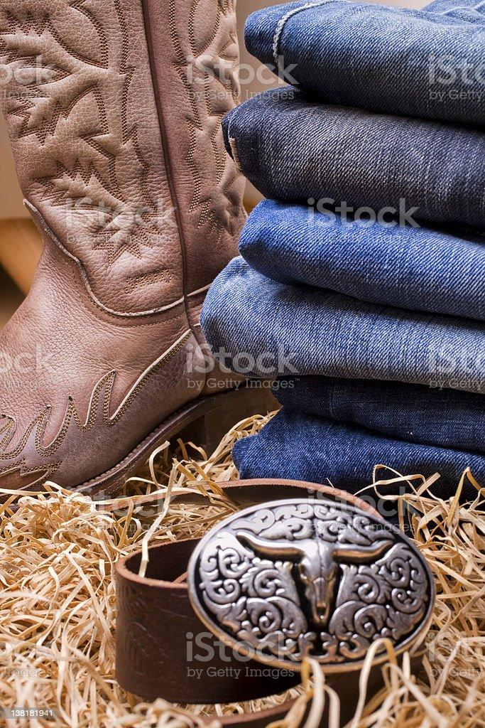 denim pants, boot and cowboy belt royalty-free stock photo
