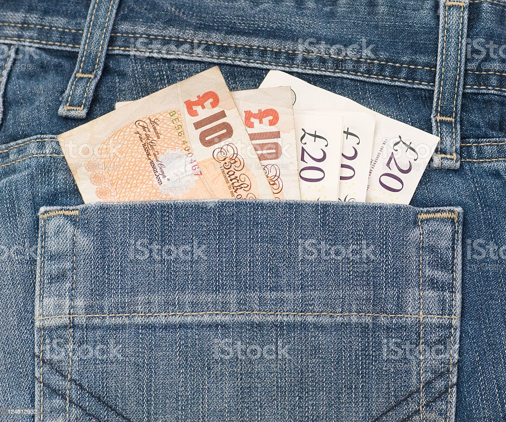 Denim Pocket full of Money stock photo