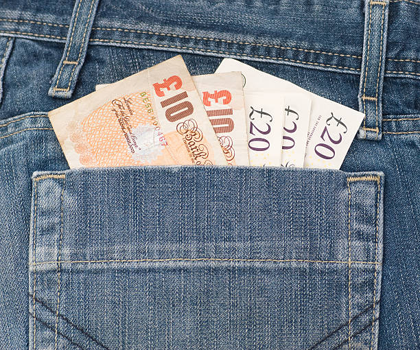 Denim Pocket full of Money Denim jean pocket full of english pound notes. ten pound note stock pictures, royalty-free photos & images