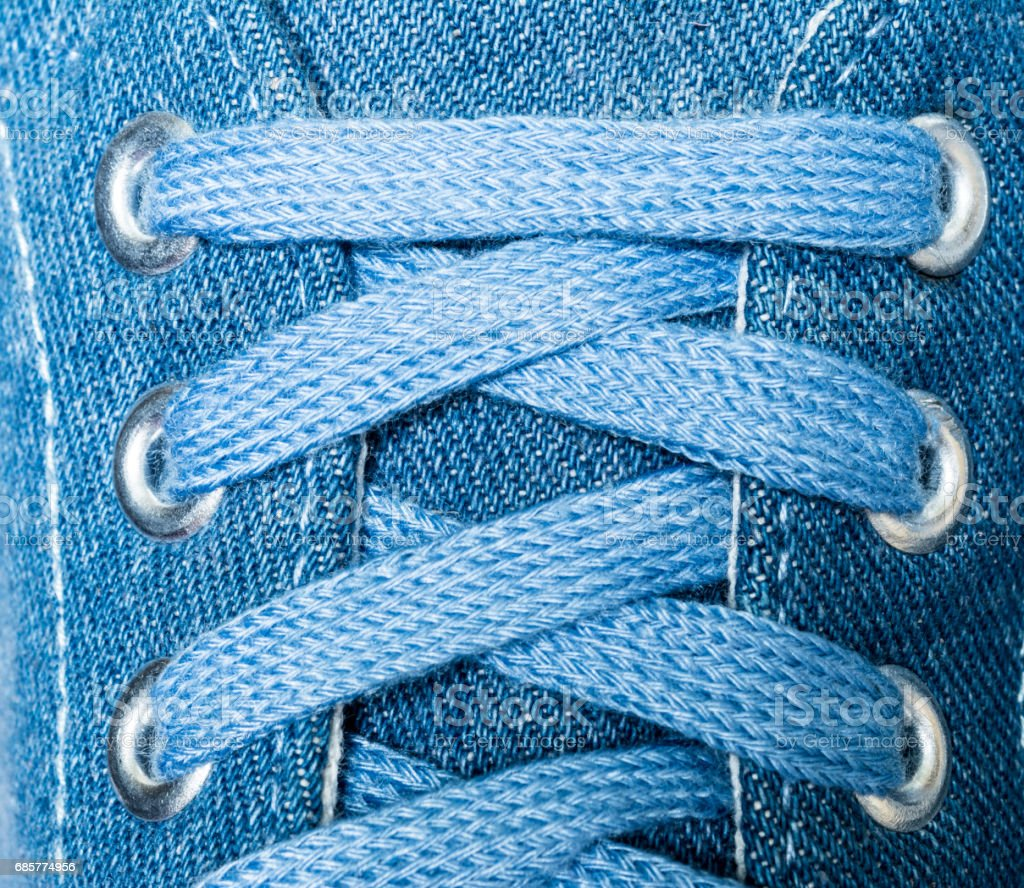 Denim sneakers close-up macro texture isolated on white background royalty-free stock photo