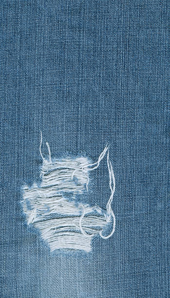 Denim texture with hole stock photo