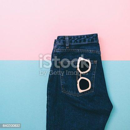 640200626istockphoto denim with pink sunglasses. 640200832
