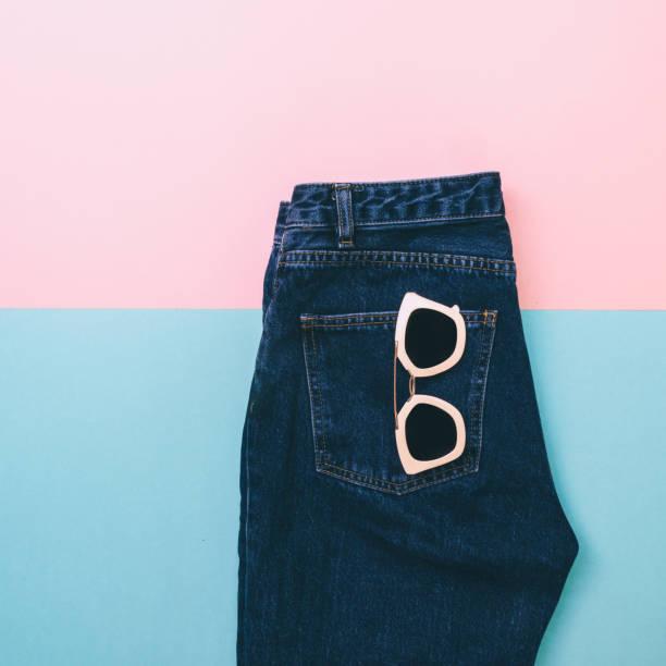 denim with pink sunglasses. - neon partylebensmittel stock-fotos und bilder
