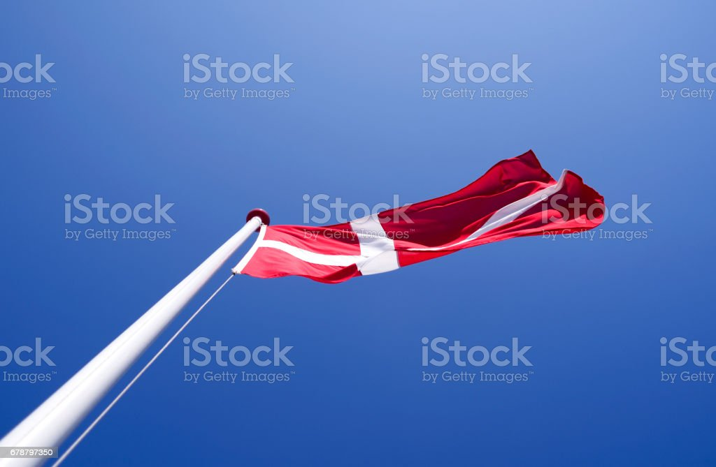 Denmark: Dannebrog fluttering in the wind royalty-free stock photo