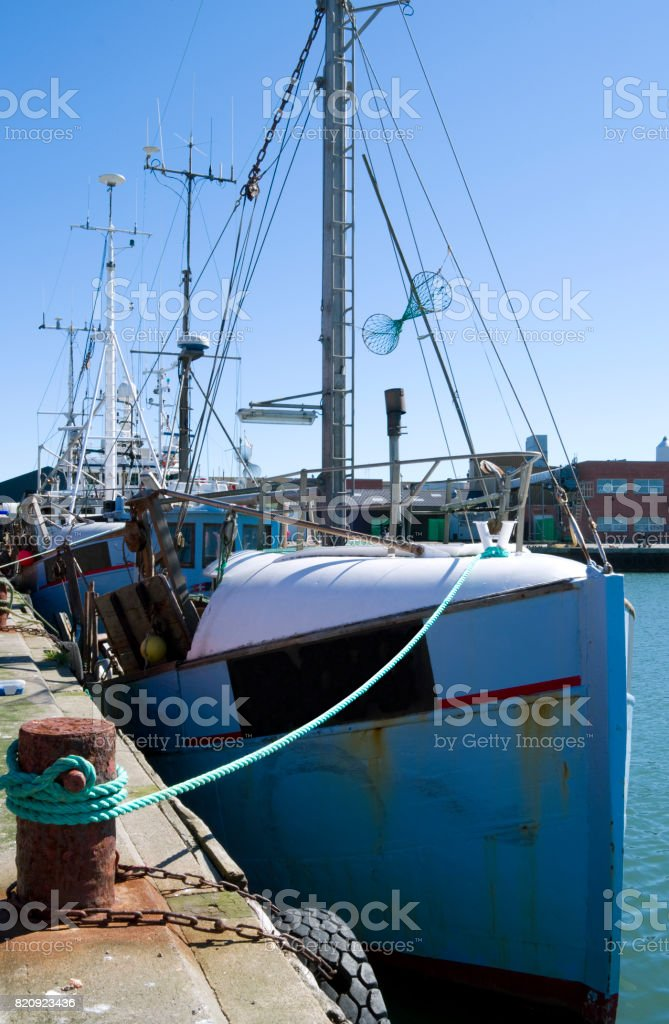 Denmark: Fishing boats at the pier in a harbour in North Jutland in summer stock photo