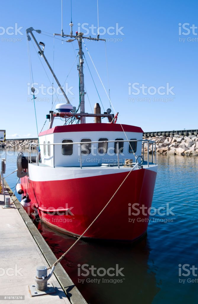 Denmark: Fishing cutter moored at the head of a pier in a small harbor in North Jutland stock photo