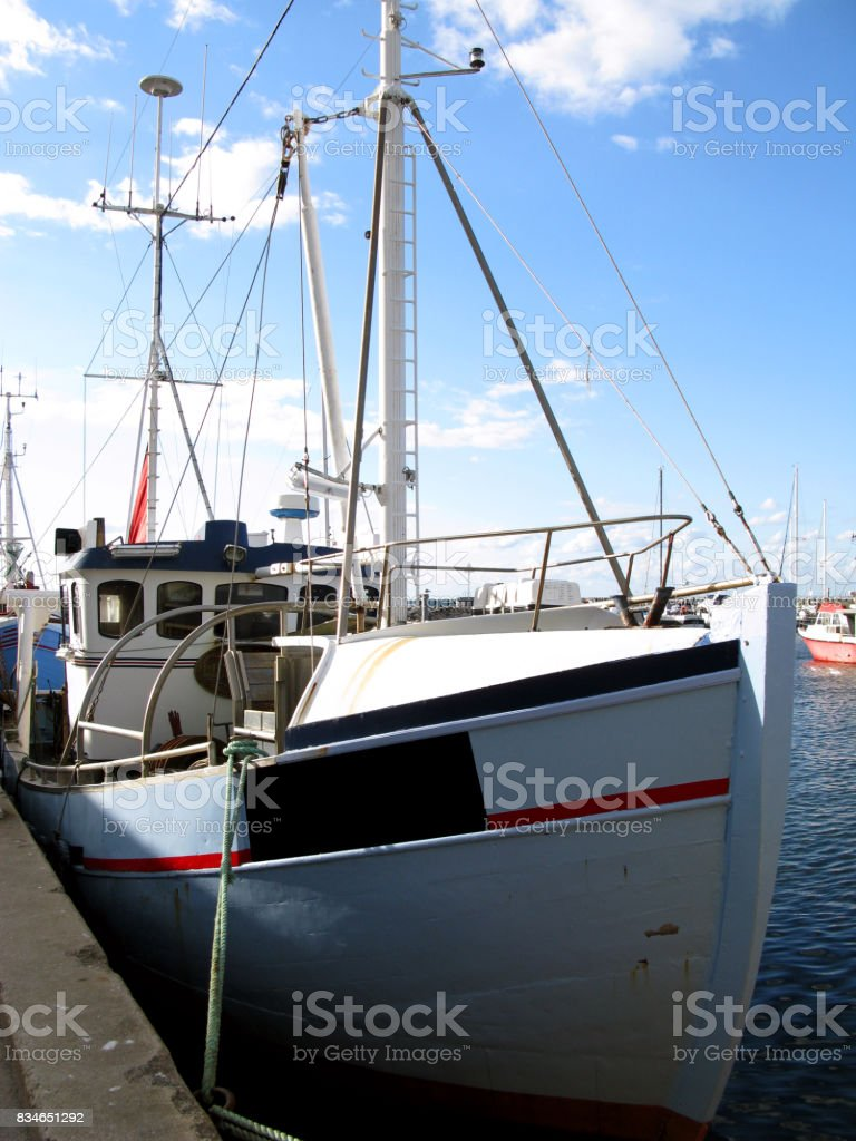 Denmark: Fishing cutter moored in a small fishing port in North Jutland stock photo
