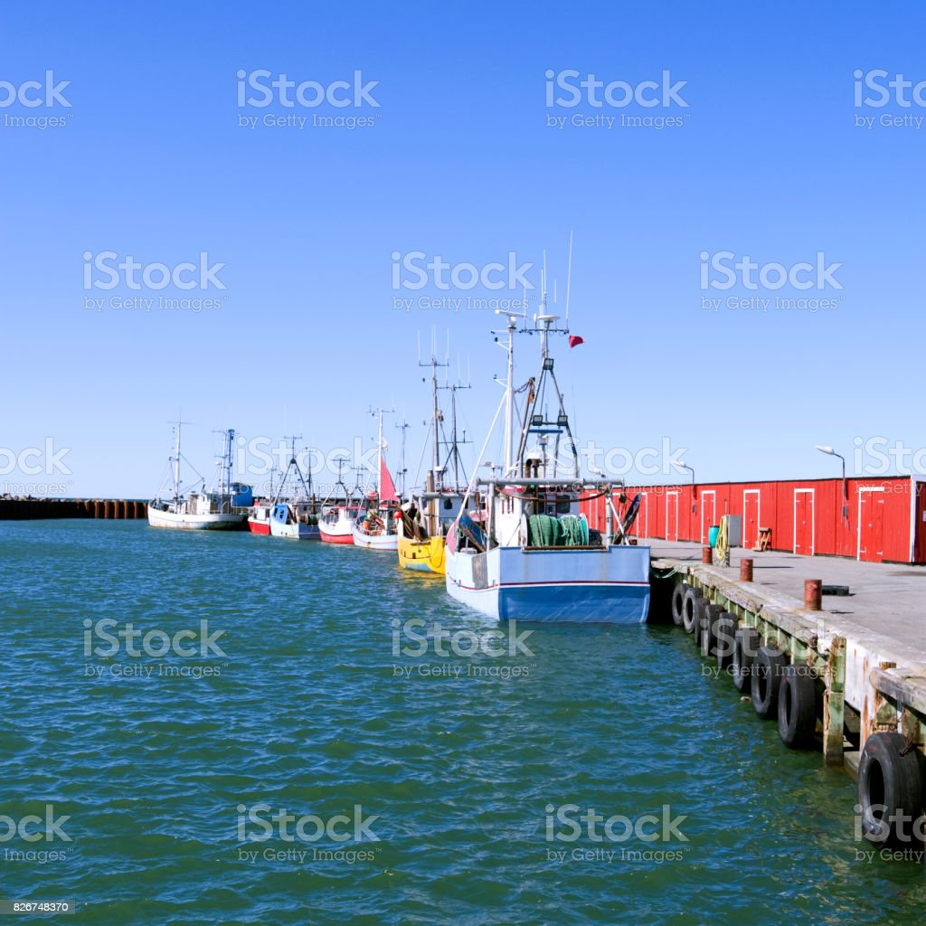 Denmark: Fishing cutters moored at the pier in a fishing port in North Jutland in April stock photo