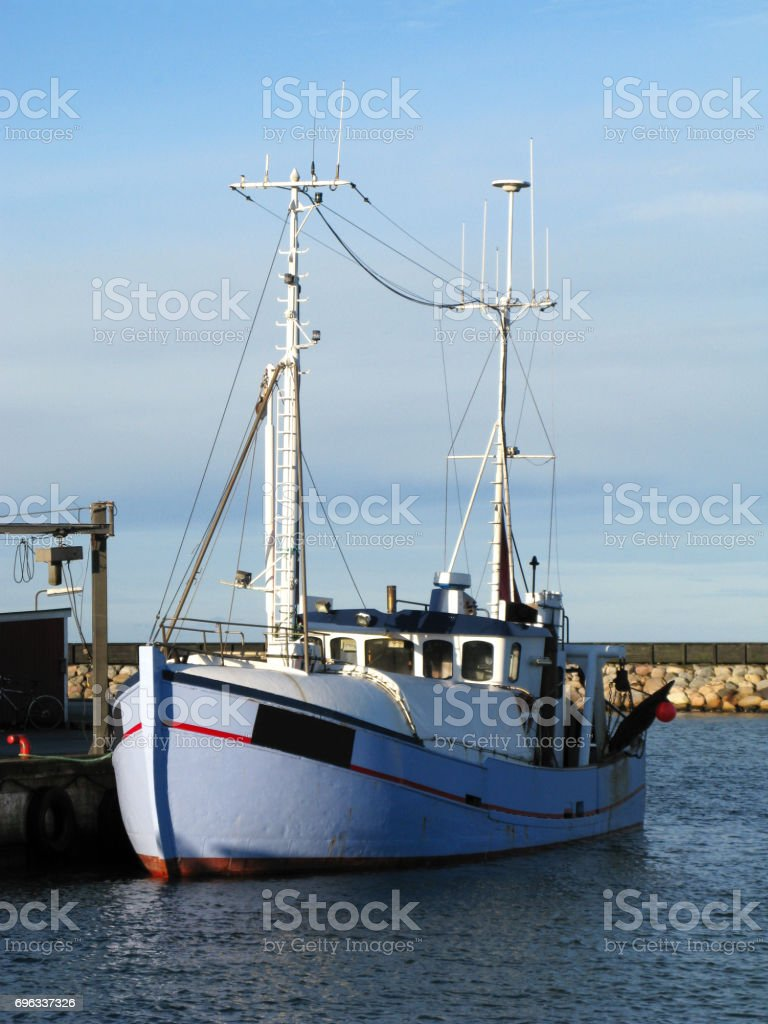 Denmark: Fishing trawler at the quayside on a sunny day in December stock photo