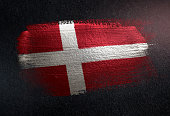 Denmark Flag Made of Metallic Brush Paint on Grunge Dark Wall