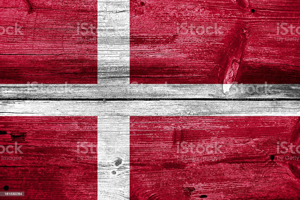 Denmark Flag painted on old wood plank background royalty-free stock photo