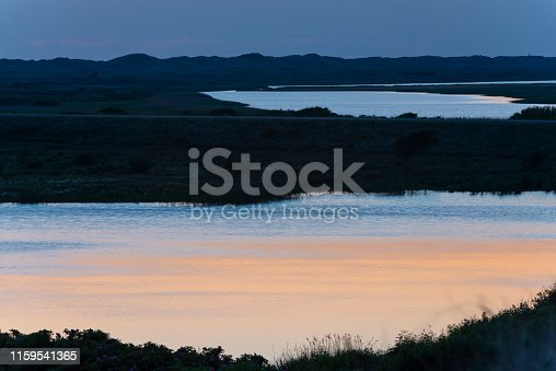 istock Denmark, Jutland, Ringkabing Fjord, Blue Hour at Nymindegab. 1159541365