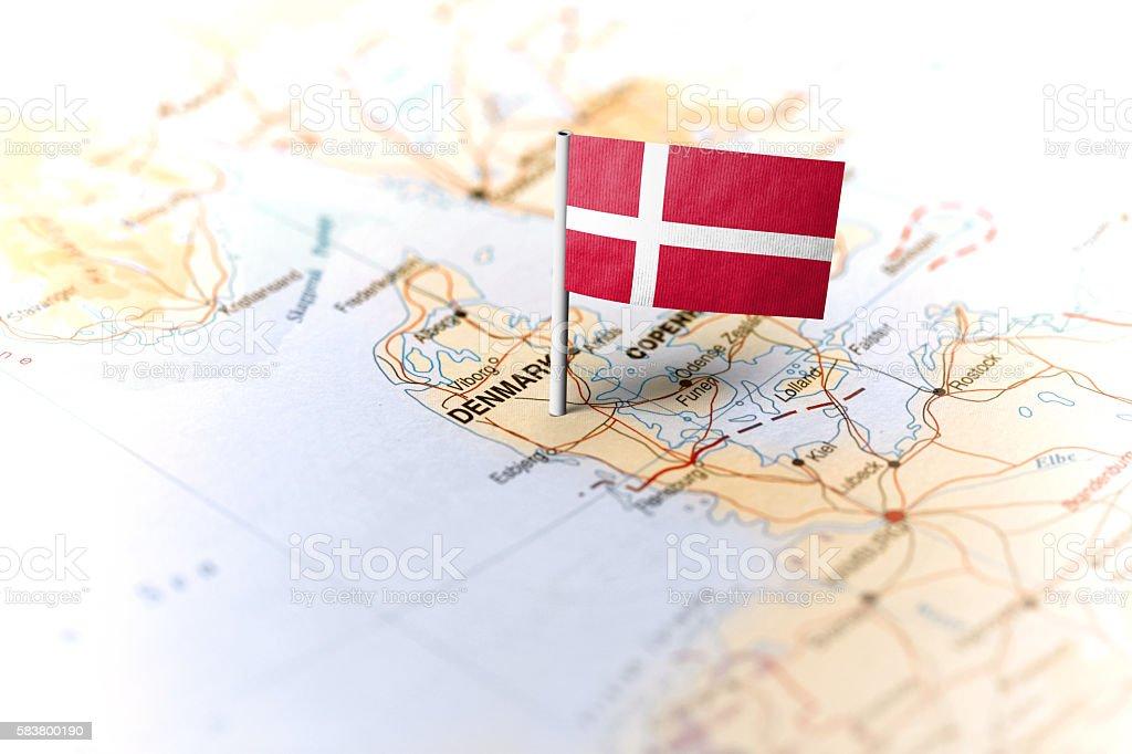 The flag of Denmark pinned on the map. Horizontal orientation. Macro...