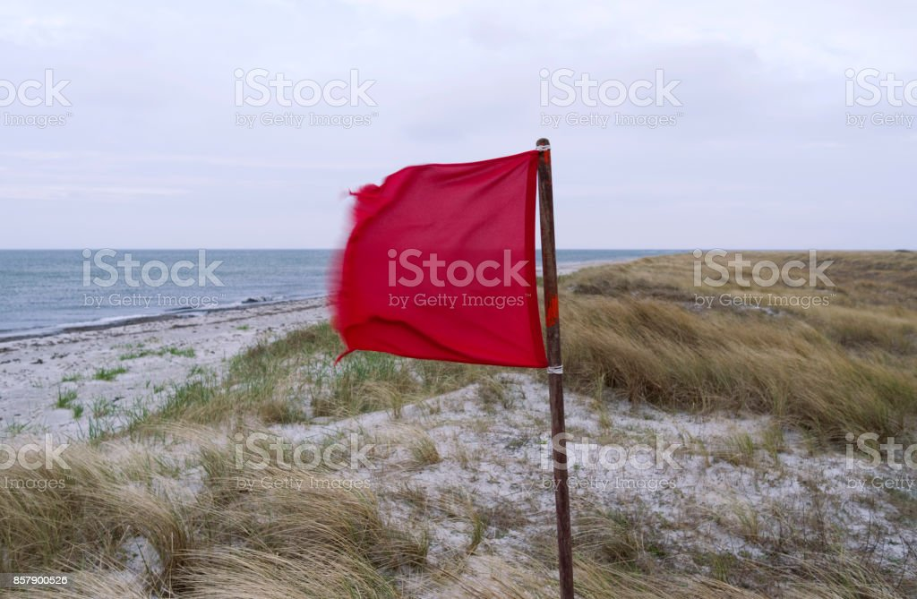 Denmark: Red flag in the dunes on Laesoe island stock photo
