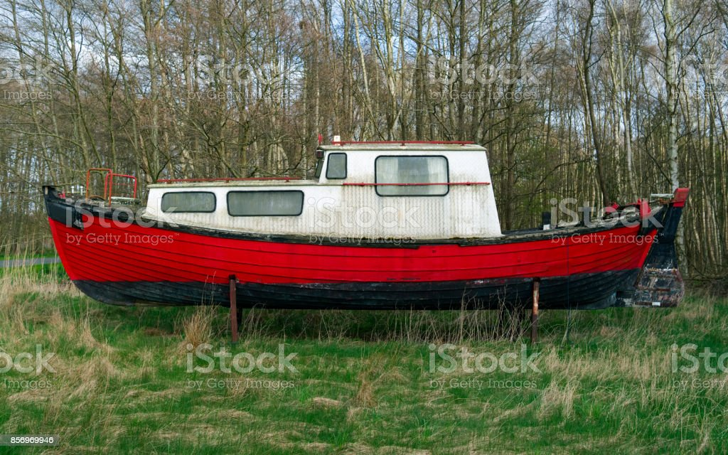 Denmark: Side view of an old boat on jacks on a wild meadow in Northern Jutland stock photo