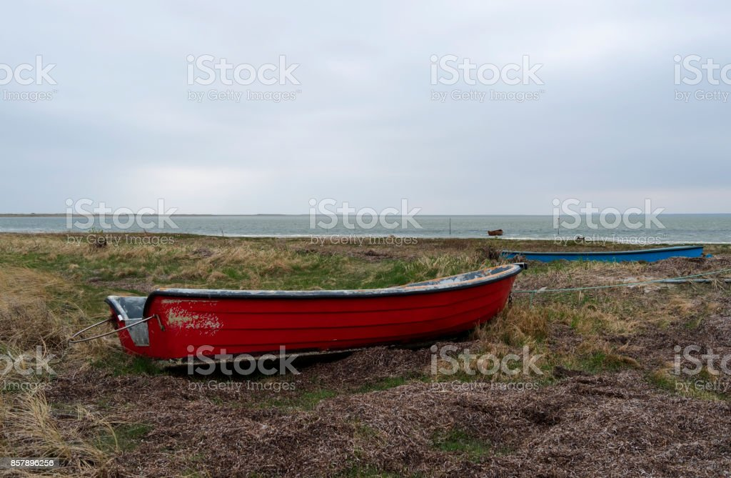 Denmark: Small fishing boats moored on the shore of the Kattegat Sea stock photo