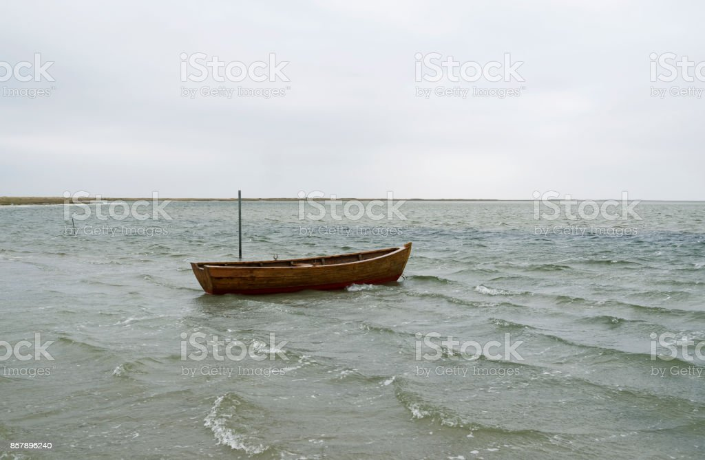 Denmark: Small wooden fishing boat anchoring in the bay at Bloeden Hale stock photo